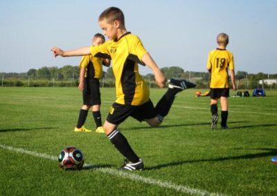 kids playing soccer at Christensen Field Arena
